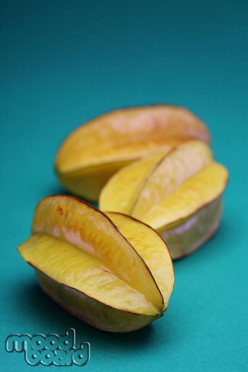 Carambola fruit on blue background