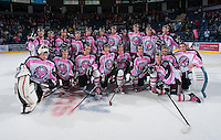 KELOWNA, CANADA - OCTOBER 20:  The Kelowna Rockets pose on the ice after Pink Power Play night for cancer research against the Brandon Wheat Kings at the Kelowna Rockets on October 20, 2012 at Prospera Place in Kelowna, British Columbia, Canada (Photo by Marissa Baecker/Shoot the Breeze) *** Local Caption ***