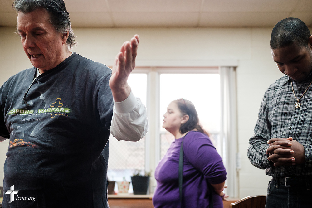 Volunteers pray before the daily dinner meal at Family of God on Wednesday, March 28, 2018, in Detroit. LCMS Communications/Erik M. Lunsford