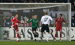 FRANKFURT, GERMANY - Wednesday, November 21, 2007: Wales' James Collins clears the ball off the goal-line to the relief of goalkeeper Wayne Hennessey during the final UEFA Euro 2008 Qualifying Group D match at the Commerzbank Arena. (Pic by David Rawcliffe/Propaganda)