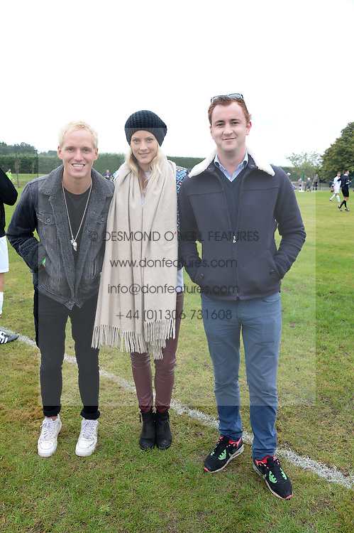 Left to right, JAMIE LAING, CHARLOTTE BAER and FRANCIS BOULLE at the Ripley Football Tournament hosted by Irene Forte in aid of The Samaritans held at Ryde Farm, Hungry Hill Lane, Ripley, Surrey on 14th September 2013.  After the football guests enjoyed an after party.