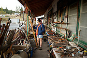 A woman at an antique and thrift store.  Clinton BC, Canada, in the Okanagan - Caribou region.