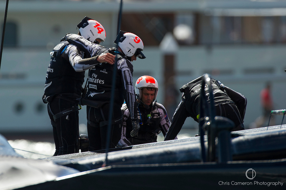 Emirates Team New Zealand sailors console each other after losing the final race of the America's Cup 34. 25/9/2013
