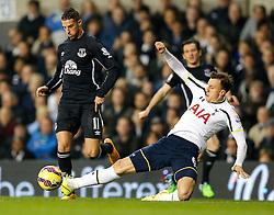 Erik Lamela of Tottenham Hotspur is tackled by Phil Jagielka of Everton - Photo mandatory by-line: Rogan Thomson/JMP - 07966 386802 - 30/11/2014 - SPORT - FOOTBALL - London, England - White Hart Lane - Tottenham Hotspur v Everton - Barclays Premier League.