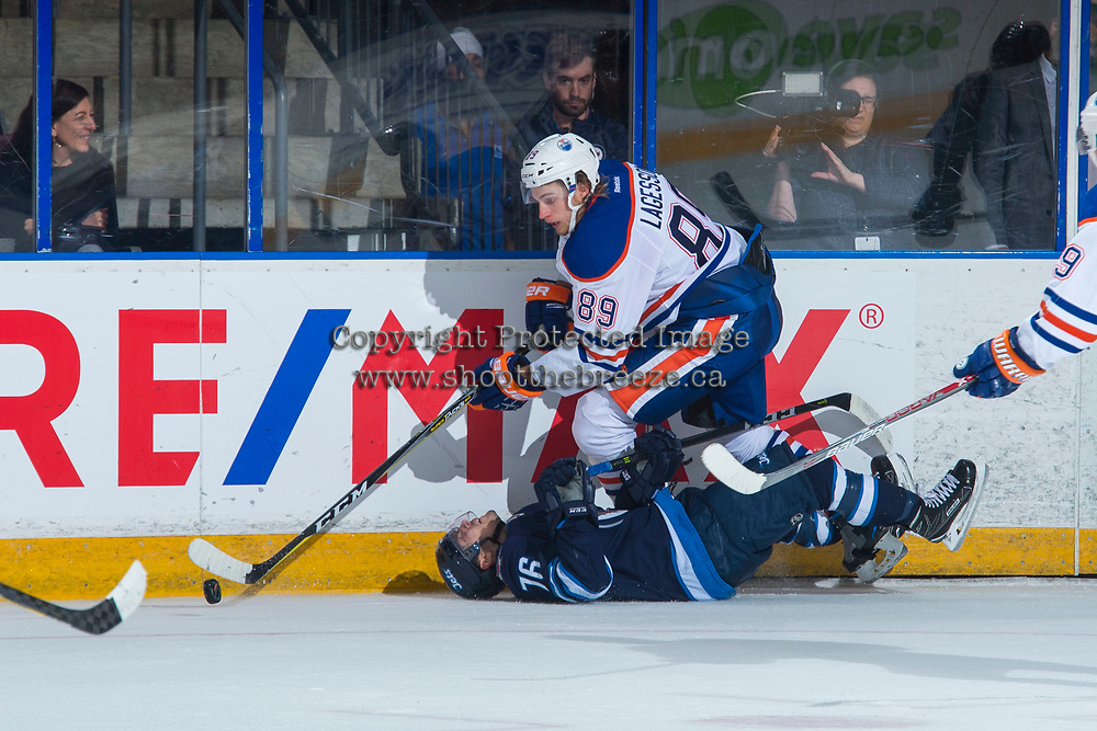 PENTICTON, CANADA - SEPTEMBER 9: William Lagesson #89 of Edmonton Oilers checks Skyler McKenzie #76 of Winnipeg Jets to the ice during second period on September 9, 2017 at the South Okanagan Event Centre in Penticton, British Columbia, Canada.  (Photo by Marissa Baecker/Shoot the Breeze)  *** Local Caption ***