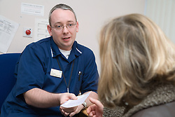 Authorised Nurse handing prescription to patient; NHS Walkin Centre Nottingham,