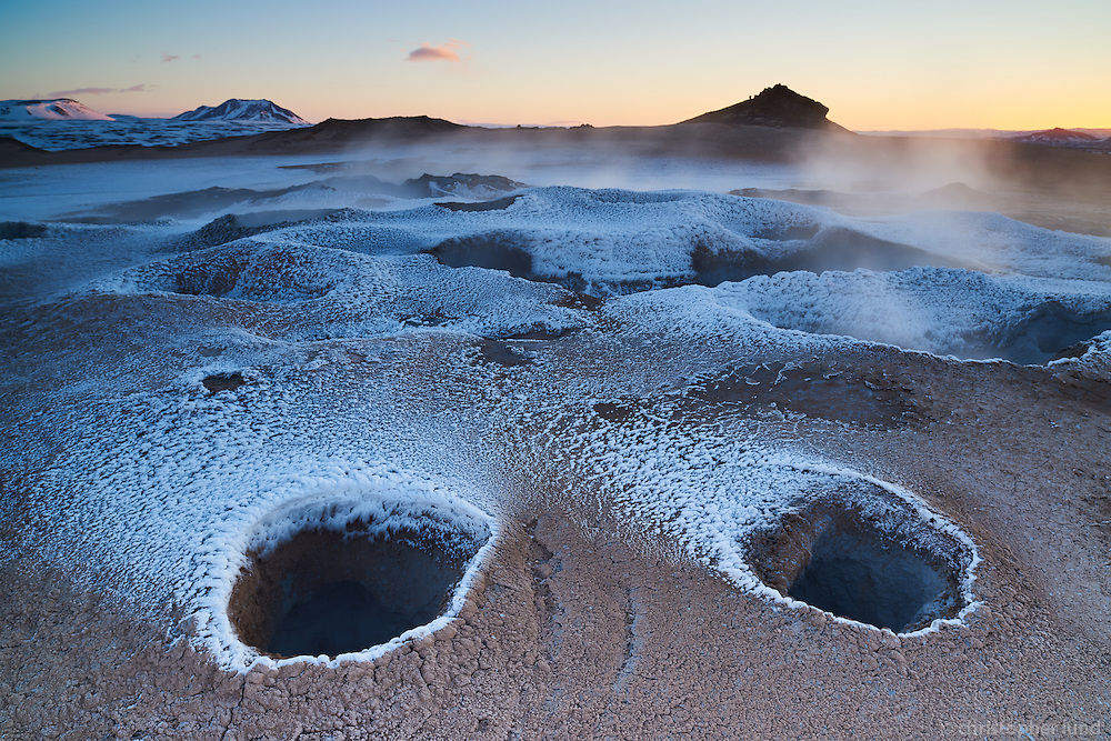 Námafjall Geothermal Area Mývatn at sunrise in winter. Mud pools boiling and steam coming from the ground. North Iceland.