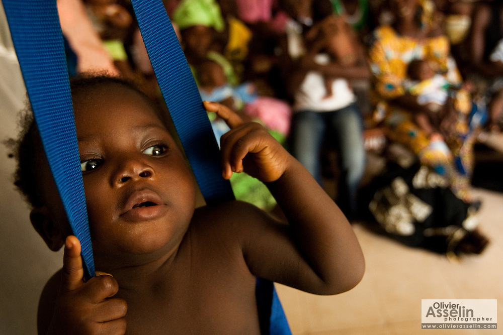 A child gets weighted at the Kono government hospital in Koidu, Sierra Leone on Wednesday March 17, 2010.