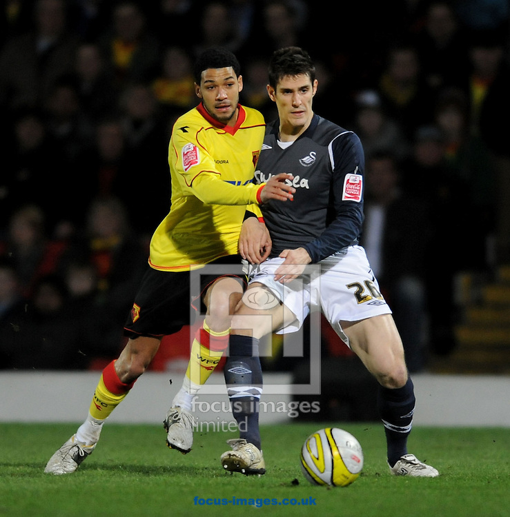 Watford - Tuesday, February 17th, 2009: Jpbi McAnuff of Watford and Albert Serran of Swansea during the Coca Cola Championship match at Vicarage Road, Watford. (Pic by Daniel Hambury/Focus Images)