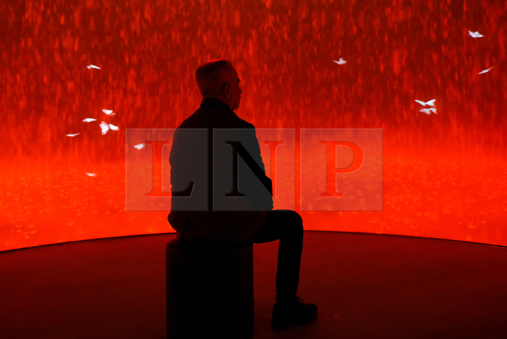 "© Licensed to London News Pictures. 25/09/2019. LONDON, UK. A visitor experiences the multi-media installation ""Introspection"", 2019, by Michelle Poonawalla at the preview of START, a contemporary art fair comprising eclectic works from a variety of international emerging artists.  The fair takes place at the Saatchi Gallery in Chelsea 26 to 29 September 2019.  Photo credit: Stephen Chung/LNP"