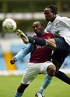 Photograph: Scott Heavey.<br />Aston Villa v Blackburn Rovers. FA Baclaycard Premiership. 05/10/2003.<br />Ricardo Gardner clears the ball  from Darius Vassell