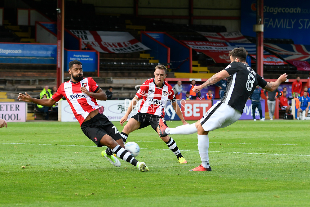 Ollie Palmer (8) of Lincoln City has his shot blocked by Luke Croll (23) of Exeter City during the EFL Sky Bet League 2 match between Exeter City and Lincoln City at St James' Park, Exeter, England on 19 August 2017. Photo by Graham Hunt.