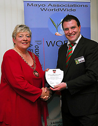 Westport Town Council honoured the Mayo Associations Worldwide with a civic reception at the start of their World Convention..Cllr Treasa McGuire Cathaoirleach of Westport Town Council made a presentation to Sean Reid Chairman of the organising committee at the reception...Pic Conor McKeown