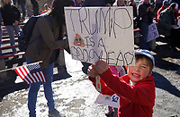 A young boy holds a sign as he waits to march through downtown Boulder, Colorado to voice their disapproval of U.S. President Donald Trump's policies Februrary 4, 2017. REUTERS/Rick Wilking