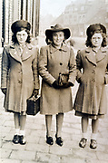 mother with two daughters standing 1940s Holland