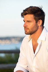 man looking off in deep thoughts