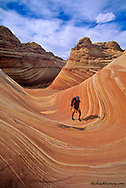 Backpacker at Coyote Buttes in the Paria Vermillion Cliffs Wilderness Area at the Utah and Arizona stateline model released