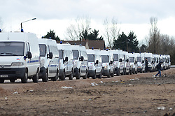 © Licensed to London News Pictures . 04/03/16 . Police vehicles lined up outside the Calais Jungle, France. French authorities are continuing to clear parts of the migrant camp.  Photo credit : Ian Homer/LNP