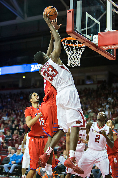 FAYETTEVILLE, AR - NOVEMBER 18:  Moses Kingsley #33 of the Arkansas Razorbacks goes up for a shot against the SMU Mustangs at Bud Walton Arena on November 18, 2013 in Fayetteville, Arkansas.  The Razorbacks defeated the Mustangs 89-78.  (Photo by Wesley Hitt/Getty Images) *** Local Caption *** Moses Kennedy