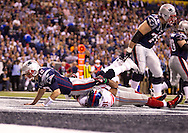 INDIANAPOLIS, IN - FEBRUARY 05:  Tom Brady #12 of the New England Patriots is sacked by  Justin Tuck #91 of the New York Giants during Super Bowl XLVI at Lucas Oil Stadium on February 5, 2012. (Photo by Tom Hauck)