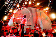 Wayne Coyne performs with his band The Flaming Lips during The Nateva Music and Camping Festival in Oxford, Maine over the 4th of July Weekend 2010.