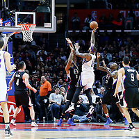 16 January 2016: Sacramento Kings center DeMarcus Cousins (15) goes for the jump shot over Los Angeles Clippers center Josh Smith (5) during the Sacramento Kings 110-103 victory over the Los Angeles Clippers, at the Staples Center, Los Angeles, California, USA.