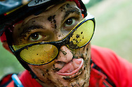 A mountain biker with a muddy face posing for the camera after a long ride in Rabbit Mountain Open Space near Lyons, CO