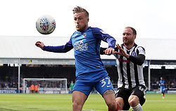 George Cooper of Peterborough United in action with Matt Done of Rochdale - Mandatory by-line: Joe Dent/JMP - 14/04/2018 - FOOTBALL - ABAX Stadium - Peterborough, England - Peterborough United v Rochdale - Sky Bet League One