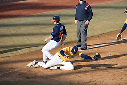 Virginia Cavaliers infielder David Adams (23)beats a throw to third in the third inning against GWU.  The Virginia Cavaliers Baseball Team defeated the George Washington University Colonials 15-2 to complete a sweep of the three game series on February 19, 2007 at Davenport Field, Charlottesville, VA.