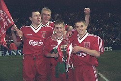 LIVERPOOL, ENGLAND - MAY 1996: Liverpool's Phil Brazier, Mark Turkington, Stuart Quinn and Michael Owen celebrate winning the FA Youth Cup after beating West Ham United during the Final 2nd Leg at Anfield. (Pic by David Rawcliffe/Propaganda)