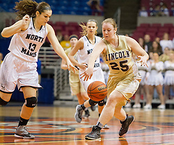 Lincoln center Josie Payton (25) and North Marion forward Cassady Rodriguez (13) go for a loose ball during a first round game at the Charleston Civic Center.