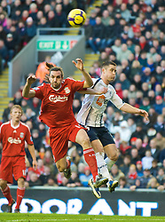 LIVERPOOL, ENGLAND - Saturday, January 30, 2010: Liverpool's Sotirios Kyrgiakos and Bolton Wanderers' Gary Cahill during the Premiership match at Anfield. (Photo by: David Rawcliffe/Propaganda)