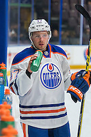 PENTICTON, CANADA - SEPTEMBER 16: Joey Benik #47 of Edmonton Oilers stands at the bench against the Vancouver Canucks on September 16, 2016 at the South Okanagan Event Centre in Penticton, British Columbia, Canada.  (Photo by Marissa Baecker/Shoot the Breeze)  *** Local Caption *** Joey Benik;
