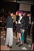 MARINA BEZHEVETS (L) & POLINA ZAKHAROVA (R) at the preview of LAPADA Art and Antiques Fair. Berkeley Sq. London. 23 September 2014.