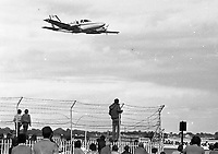 Twin Engine Aircraft at the Air Spectacular in Fairyhouse, Meath, as spectators below follow their flight, 22/08/1982 (Part of the Independent Newspapers Ireland/NLI Collection).