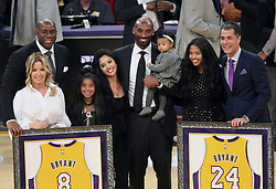 December 18, 2017 - Los Angeles, California, U.S - (L-R) Magic Johnson, Jeanie Buss, Kobe Bryant, wife Vanessa Bryant and daughters Gianna Maria Onore, Natalia Diamante, Bianka Bella and Rob Pelinka pose during Kobe Bryant's jersey retirement ceremony at halftime of a basketball game between the Los Angeles Lakers and the Golden State Warriors at Staples Center on Monday December 18, 2017 in Los Angeles, California. (Credit Image: © Prensa Internacional via ZUMA Wire)