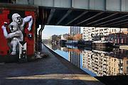 Street art beneath a bridge over the Canal de l'Ourcq in the 19th arrondissement of Paris, France. The Canal de l'Ourcq is a 108.1km waterway begun in 1802 between Port-aux-Perches and the Canal Saint-Martin via the Bassin de la Villette or La Villette Basin. Picture by Manuel Cohen