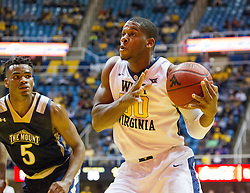 Nov 11, 2016; Morgantown, WV, USA; West Virginia Mountaineers forward Sagaba Konate (50) shoots in the lane during the second half against the Mount St. Mary's Mountaineers at WVU Coliseum. Mandatory Credit: Ben Queen-USA TODAY Sports