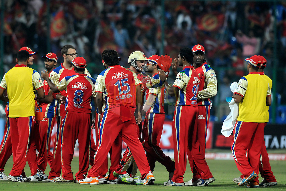 Team Royal Challengers Bangalore celebrates a wicket during match 1 of the NOKIA Champions League T20 ( CLT20 )between the Royal Challengers Bangalore and the Warriors held at the  M.Chinnaswamy Stadium in Bangalore , Karnataka, India on the 23rd September 2011..Photo by Pal Pillai/BCCI/SPORTZPICS