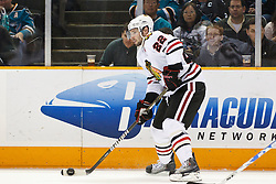 December 11, 2010; San Jose, CA, USA;  Chicago Blackhawks right wing Troy Brouwer (22) passes the puck against the San Jose Sharks during the first period at HP Pavilion. San Jose defeated Chicago 2-1 in overtime. Mandatory Credit: Jason O. Watson / US PRESSWIRE