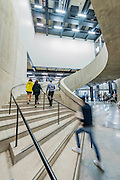 The interior features lightwells and curving staircases - The new Tate Modern will open to the public on Friday 17 June. The new Switch House building is designed by architects Herzog & de Meuron, who also designed the original conversion of the Bankside Power Station in 2000.