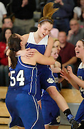 Wallkill's Katlyn Ponesse, left, Kristin Lundy, center, and Alyssa Cheslo-Brown, right, celebrate after their team defeated John A. Coleman 36-34 in the Mid-Hudson Athletic League championship game at Ulster County Community College in Stone Ridge on Friday, Feb. 18, 2011.