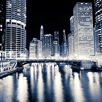 Chicago at night at Dearborn Street Bridge along the Chicago River with Marina City Towers, Trump Tower, 333 North Michigan, London Guarantee Building / Crain Communications Building (360 North Michigan) Mather Tower (75 East Wacker Drive), Hotel 71 Building, Unitrin Building, and Leo Burnett Building.