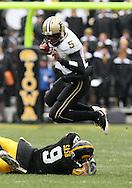 15 NOVEMBER 2008: Purdue quarterback Justin Siller (5) jumps over Iowa defensive back Tyler Sash (9) in the second half of an NCAA college football game against Purdue, at Kinnick Stadium in Iowa City, Iowa on Saturday Nov. 15, 2008. Iowa beat Purdue 22-17.