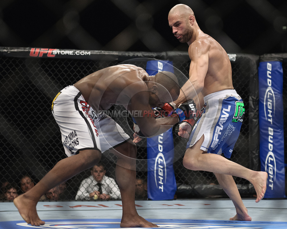 """LONDON, ENGLAND, OCTOBER 2010: Claude Patrick (left) is clipped by a punch from James Wilks during """"UFC 120: Bisping vs. Akiyama"""" inside the O2 Arena in Greenwich, London"""
