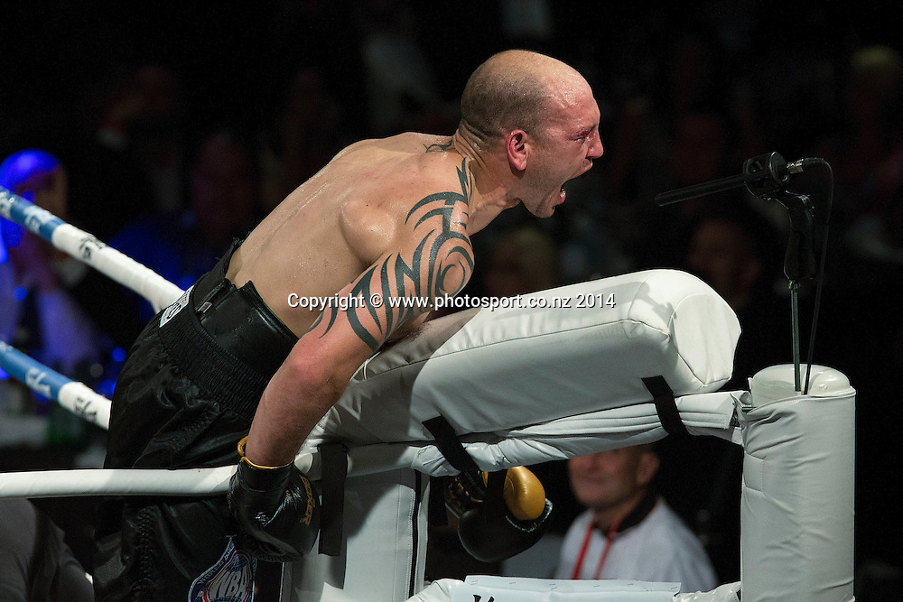 Anthony McCracken celebrates defeating David Aloua in the Mahindra Super 8 Fight Night, North Shore Events Centre, Auckland, New Zealand, Saturday, November 22, 2014. Photo: David Rowland/Photosport