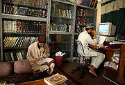 Abdul Razzaq, coordinator of the Darul Uloom Naeemia, right, types and compiles the Islamic book of Hadhees on a computer in Karachi, Pakistan.