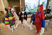 Grand opening of Skyrex luxury office real estate. Traditional wooden mask dancers.