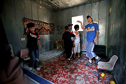 Sderot  - May 2nd ,  2008 -  Children play inside a bomb shelter in the centre of Sderot, Southern Israel, The small town has frequent rocket attacks from Gaza  , May 2nd, 2008. Picture by Andrew Parsons / i-Images