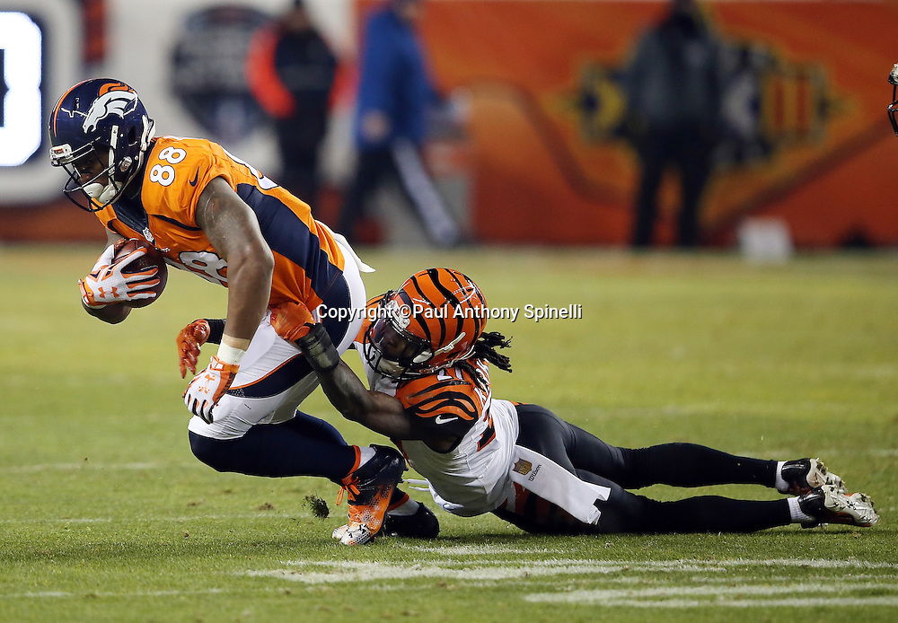Denver Broncos wide receiver Demaryius Thomas (88) gets tackled by Cincinnati Bengals cornerback Dre Kirkpatrick (27) after catching a third quarter pass for a gain of 7 yards during the 2015 NFL week 16 regular season football game against the Cincinnati Bengals on Monday, Dec. 28, 2015 in Denver. The Broncos won the game in overtime 20-17. (©Paul Anthony Spinelli)